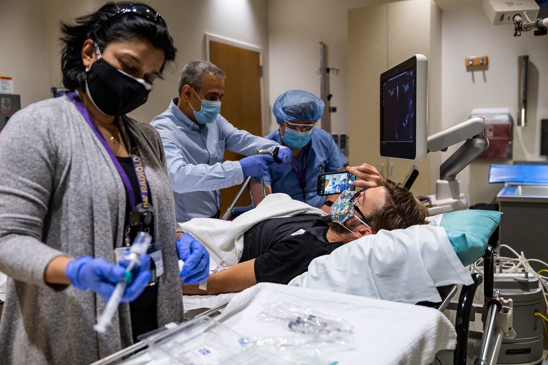 researchers and medical professionals preparing for the ultrasound scan